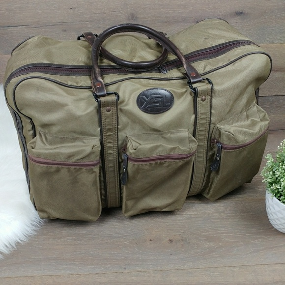 Vintage YSL Army Green Travel Duffle Bag. M 5bf47ea0e944ba57dcdba52d. Other  Bags you may like. YVES SAINT LAURENT ... e3e58e0a79f45
